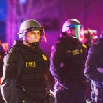 Police in Riot Gear at night